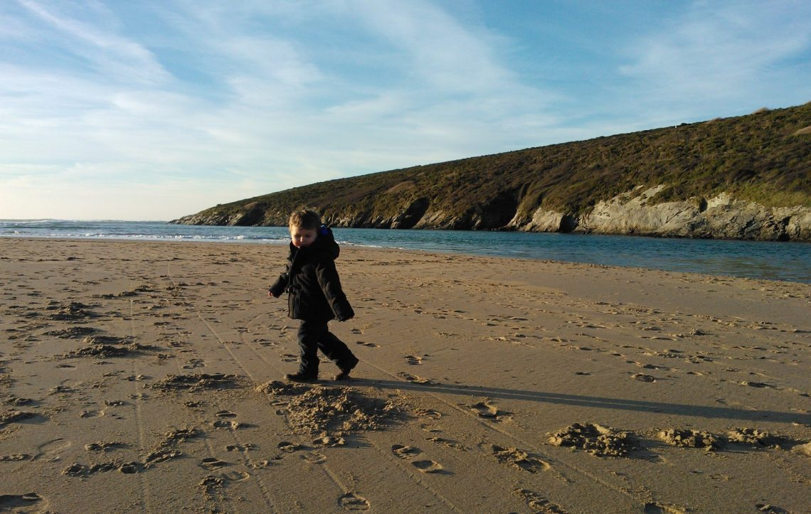 Son on the beach, by Tracey Pender