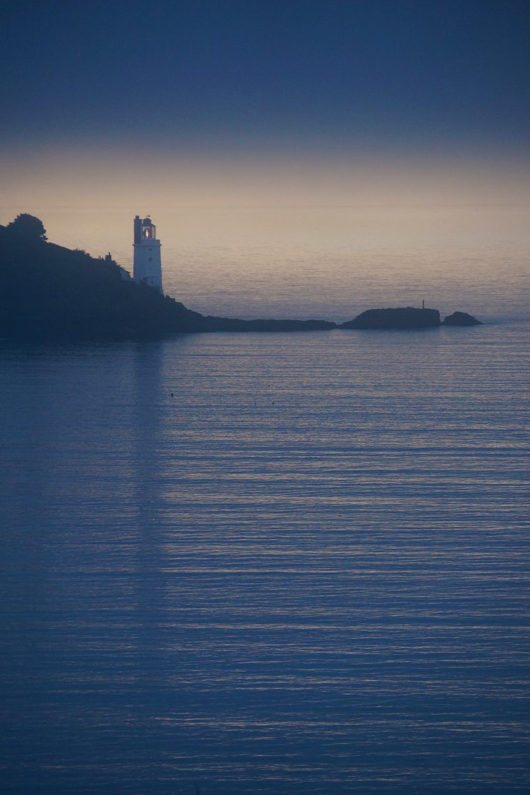 Misty break of dawn in Autumn - St Anthony's Lighthouse on Roseland Peninsula, from St Mawes by Ollie Woodman-Smith