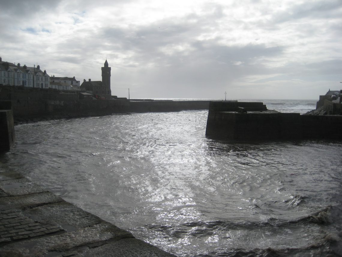 Porthleven Harbour empty of boats Cornwall