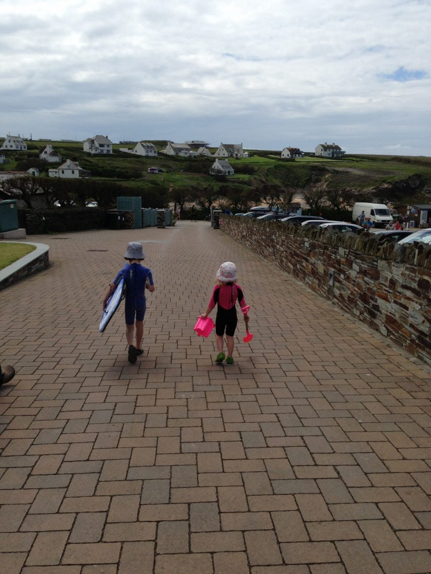 Children off to the beach at Treyarnon bay Cornwall